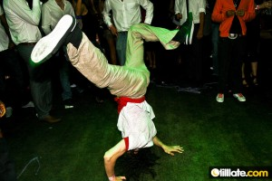 B-Boy Twist of the Masterz Breakdance Crew performing an elbow freeze at CandyPants at Oracle Nightclub and Bar